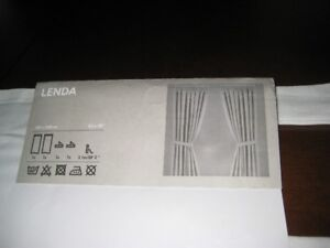 curtains -  new in package - 2 panels, each 55 in x 98 in