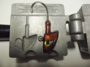 2 fishing jig molds, tackle, lure, rod, reel.