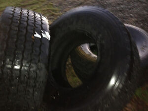 Two 445/65R 22.5 wide front dump truck tires