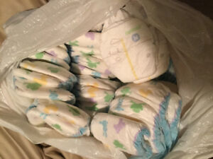 Diapers leftover size n and 1.