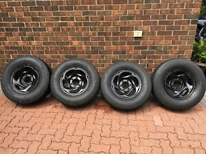 255/70/R16 Winter (4) tires with great black rims !!