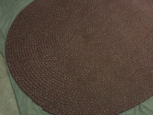 Braided Oval Rug, Burgundy with White and Green Flecks.