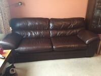 Matching pair 2 and 3 seater dark brown leather sofas + footstool good condition