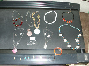 Necklace and earring sets.