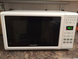 2 year old Sylvania Household Microwave $40 obo!!