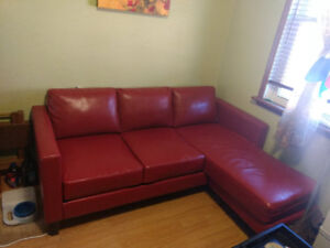 Stylish and trendy red faux leather sofa