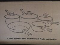 Stainless Steel 5 piece pan set with lids.