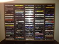100 MUSIC CASSETTES IN DISPLAY CASE -ONLY $75