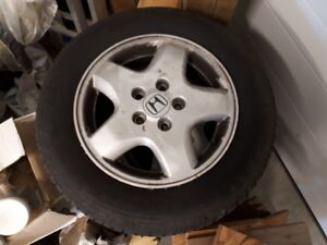 set of 4 tires mounted on rims