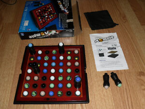 Stomple - family strategy board game - plays with marbles