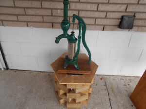 CAST IRON AND METAL PUMP.