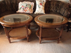 two solid wooden end tables, sturdy with glass tops.