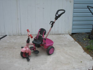 Little Tikes push/peddle trick.  In good condition.