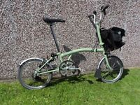 Brompton M6L folding bike in sage green