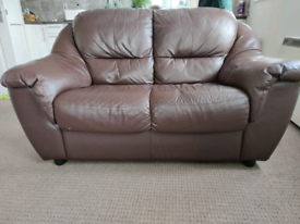 2 sofas and pouffe