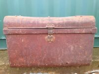Two metal travel trunks