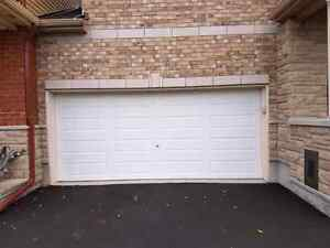 16x7 garage door as new.