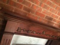 Wooden mantle with hand carved detail