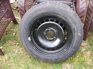 NEW NEVER USED MICHELIN ON VW RIM 195/65/15