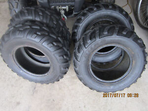 SET OF 4  25 in. TIRES 2--25X8X12  & 2--25X10X12  GOOD CONDITION