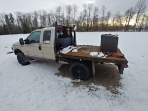 2001 F350 Super cab diesel with deck on it.