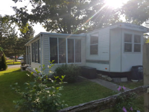 Beautiful Park Model with Sunroom with large private lot