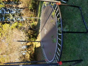Oval 13' 'Outbound' trampoline with safety enclosure.