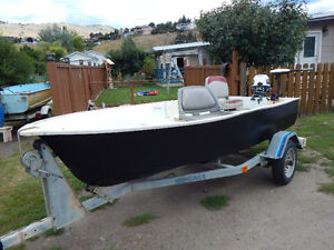 12-ft Fiberglass boat and accessories priced for quick sale.