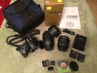 Nikon D3100 with 18-55mm, 55-200mm zoom lens and extra battery