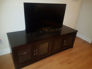 Solid wood television stand with glass doors
