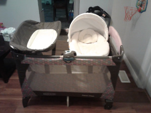 Graco three in one bassinet, change table, and playpen