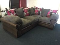 Grey cord fabric and leatherette right hand side double arm L shape corner sofa floral red cushions