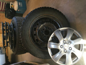 4 WINTER TIRES, RIMS, HUBCAPS from 2008 Mitsubishi Lancer