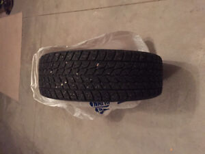 4 Used Snow Tires with Rims