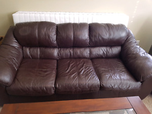 Brown bonded leather couch and loveseat