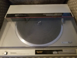 Technics Turntable (record player) and various records.