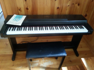 Yamaha CPL 560 Clavinova electric piano with bench