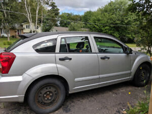 2008 Dodge Caliber for sale for parts, with extra set of rims.