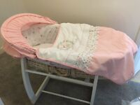Moses basket with rocking stand and pink accessories