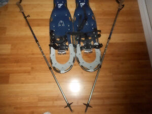 Nice pair of snow shoes with pair of sticks and bag
