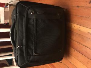 Rolling carryall-travel bag