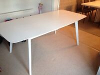 White 4-6 seater dining table