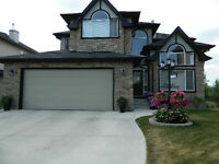 Okotoks Beautiful Executive Family Home on Golf Course