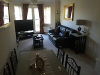 Double room with own bathroom, good broadband and parking. Walking distance to mainline station.