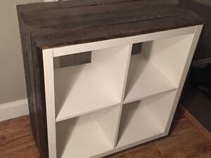 Cube shelf cladded in aged wood