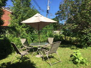 Out door table set with chairs and umbrella