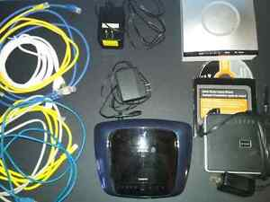 Three internet WiFi modem/routers and ethernet cables