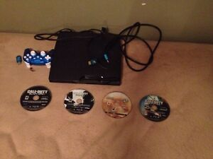 PS3 with 4 games and a controller