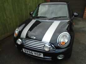 Mini 1.6 Cooper. AC. CD/AUX. EW. EM. RCL. WARRANTY. ALLOYS. PRIVACY.