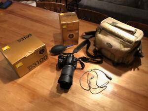 Nikon D3100 + Nikkor lens 18-105mm + 2x4GB SD-card + Roots bag